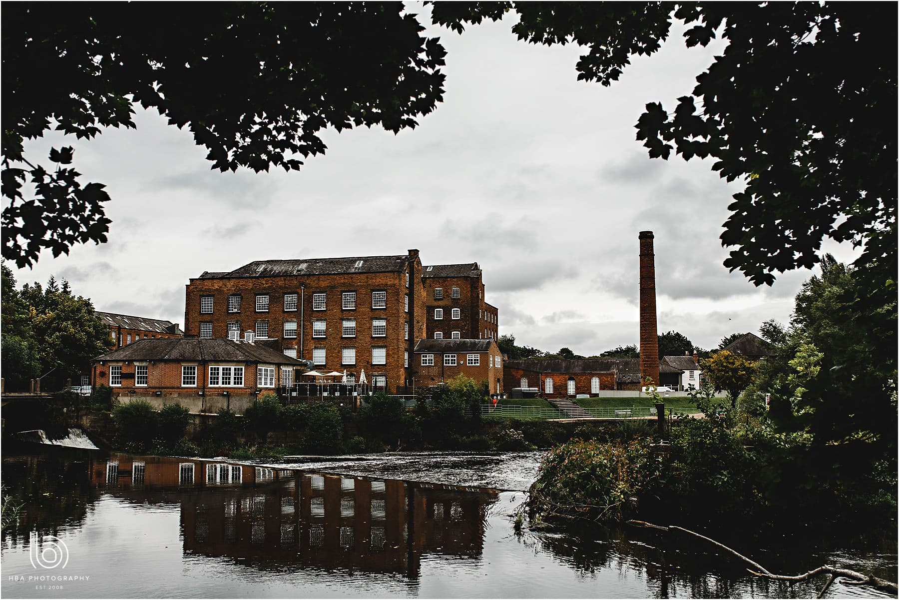 a photo of the west mill wedding venue from accross the river