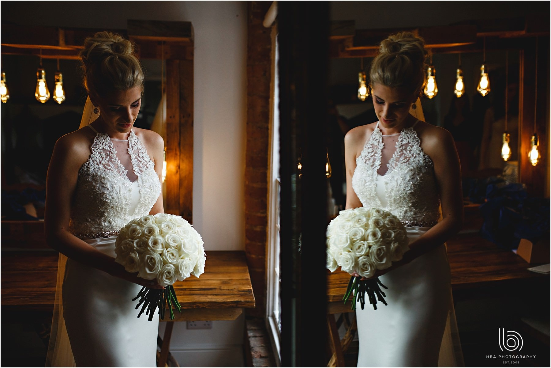 the bride and her boquet looking into the mirror