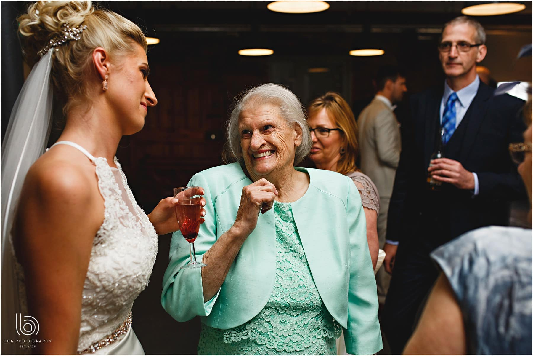 the bride and her grandmother laughing at her wedding