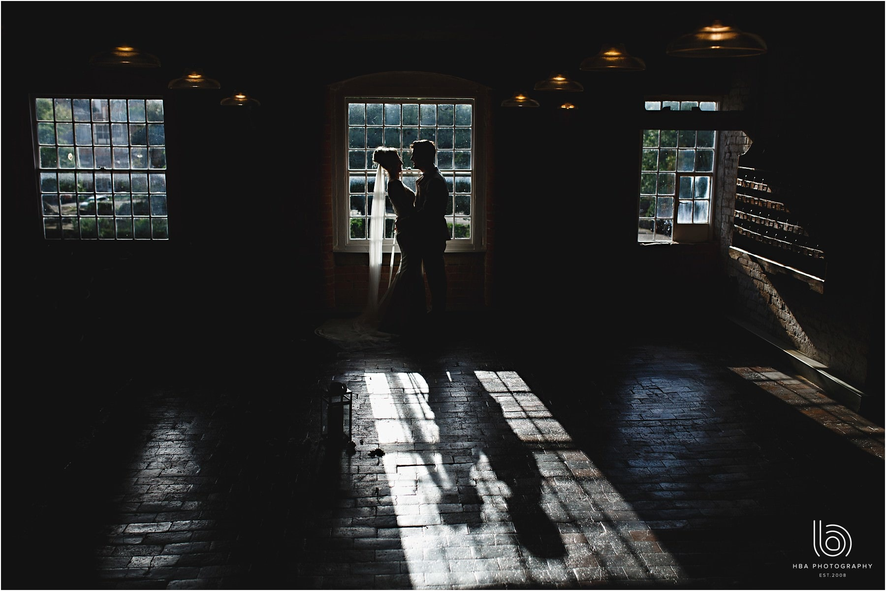 the bride and groom stood together in darkness at the west mill