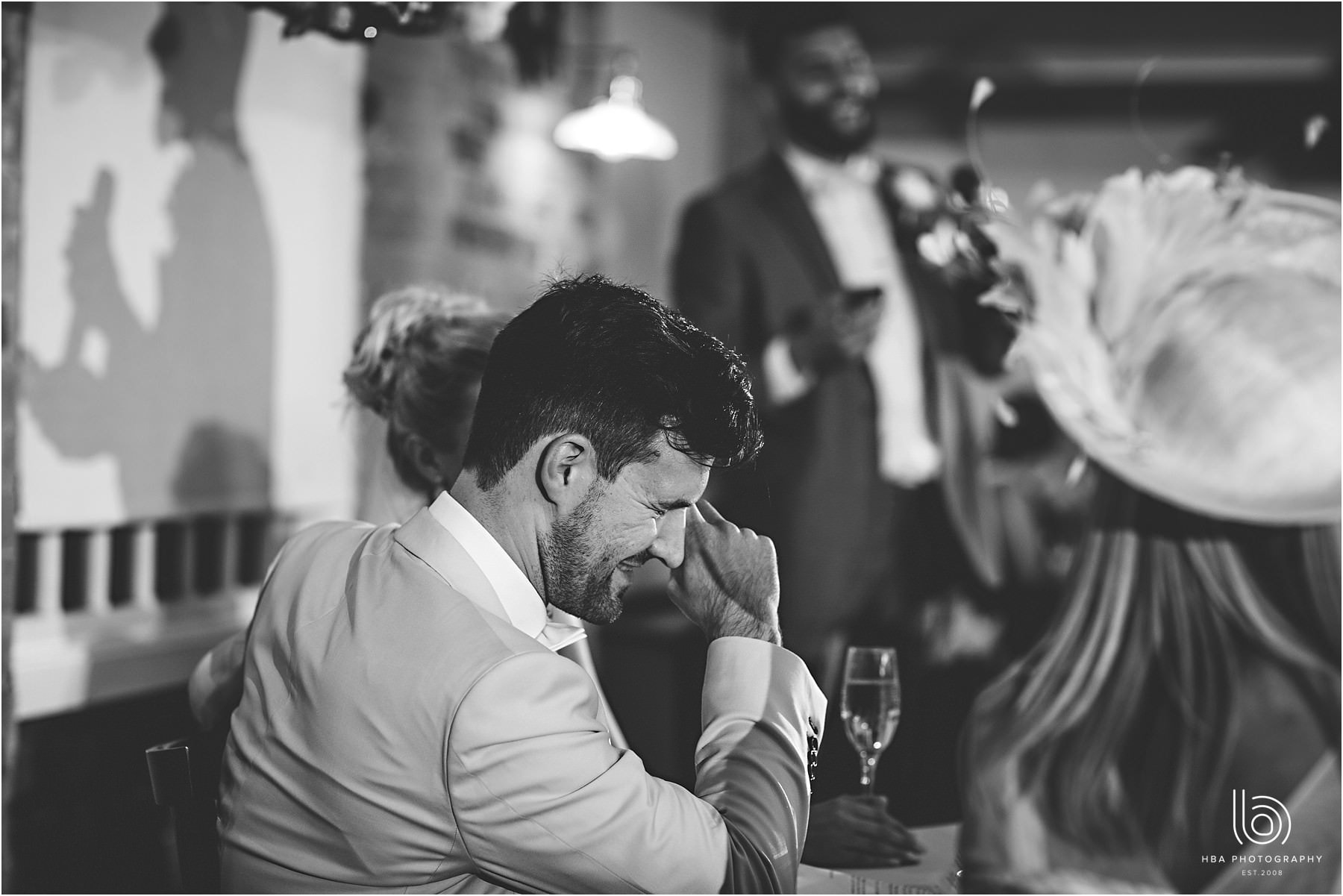 the groom laughing at the best mans speech