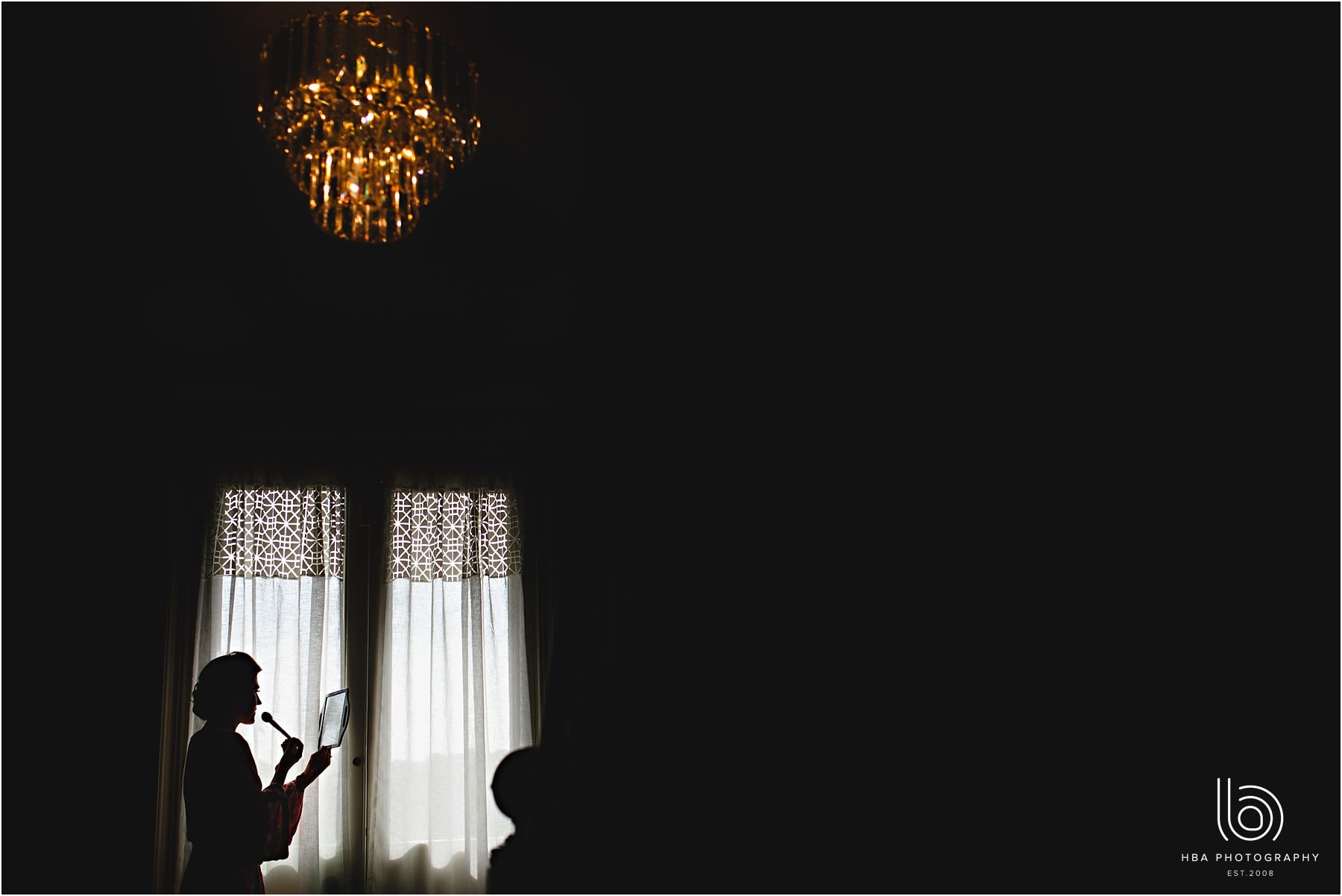 the bride in silhouette in the window