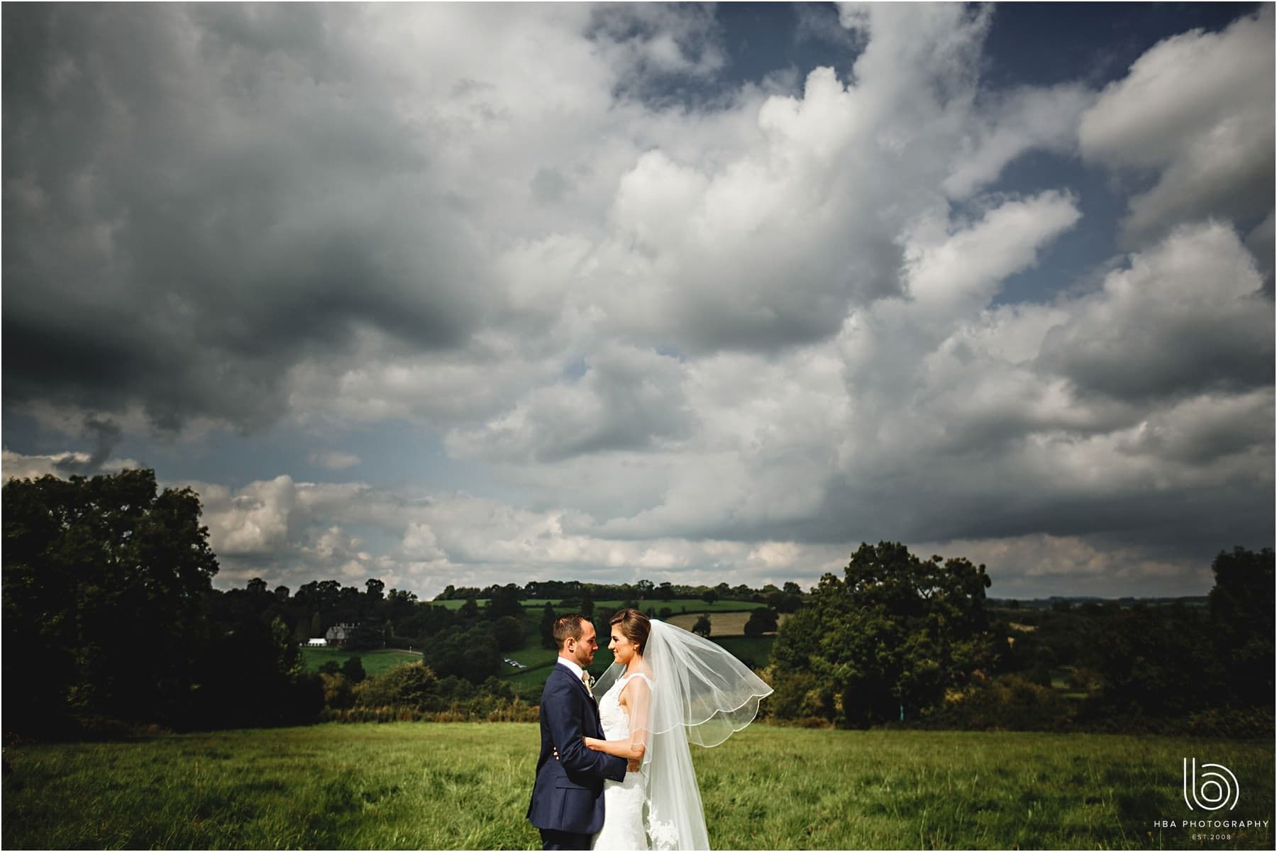 the bride & groom at home with a beautiful view in the background