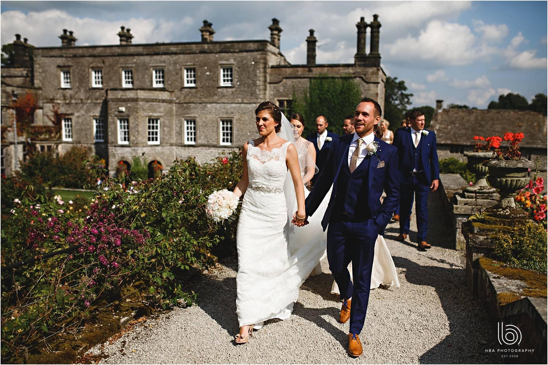 the bride & groom walking at Tissington Hall