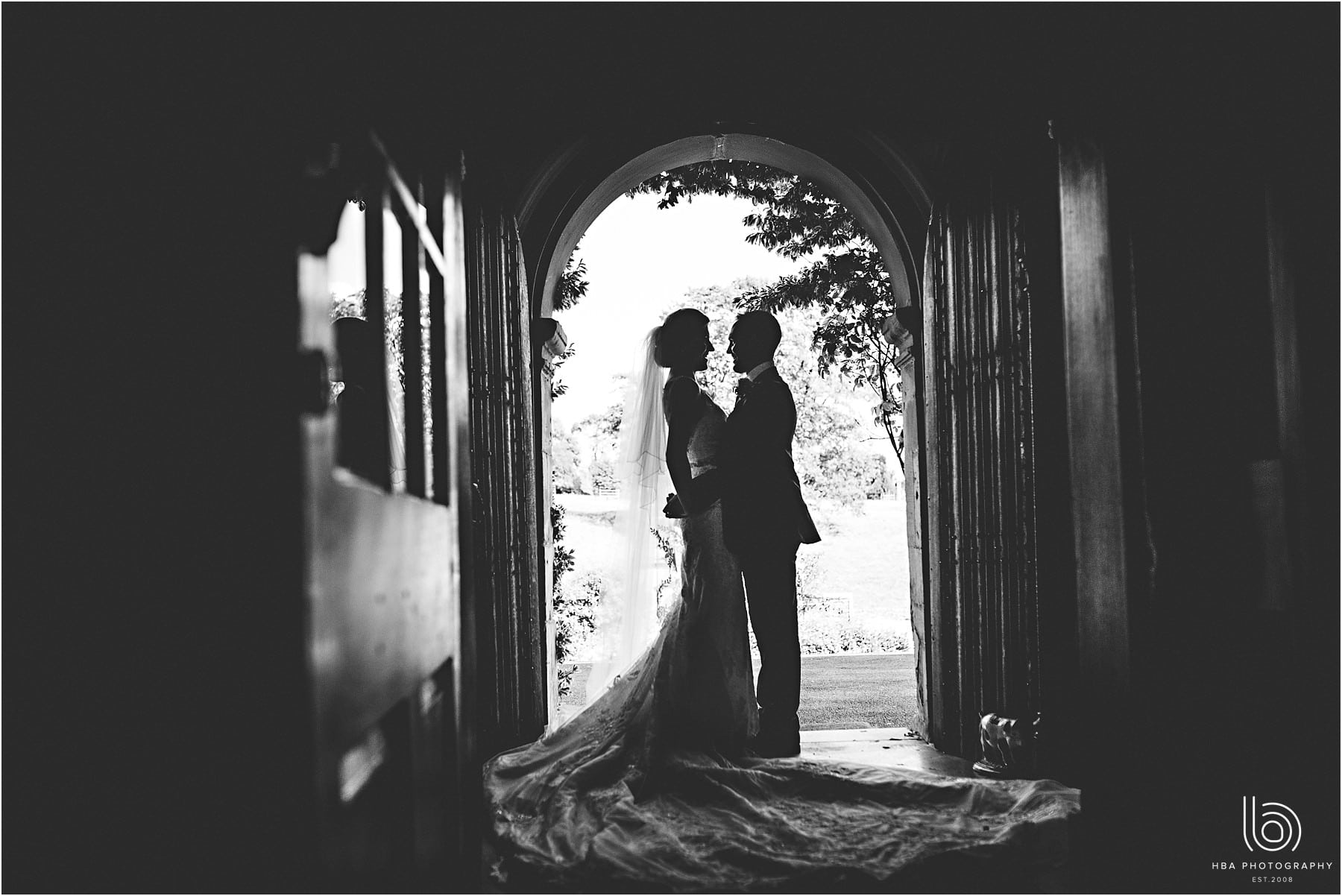 the bride & groom in silhouette at Tissington Hall