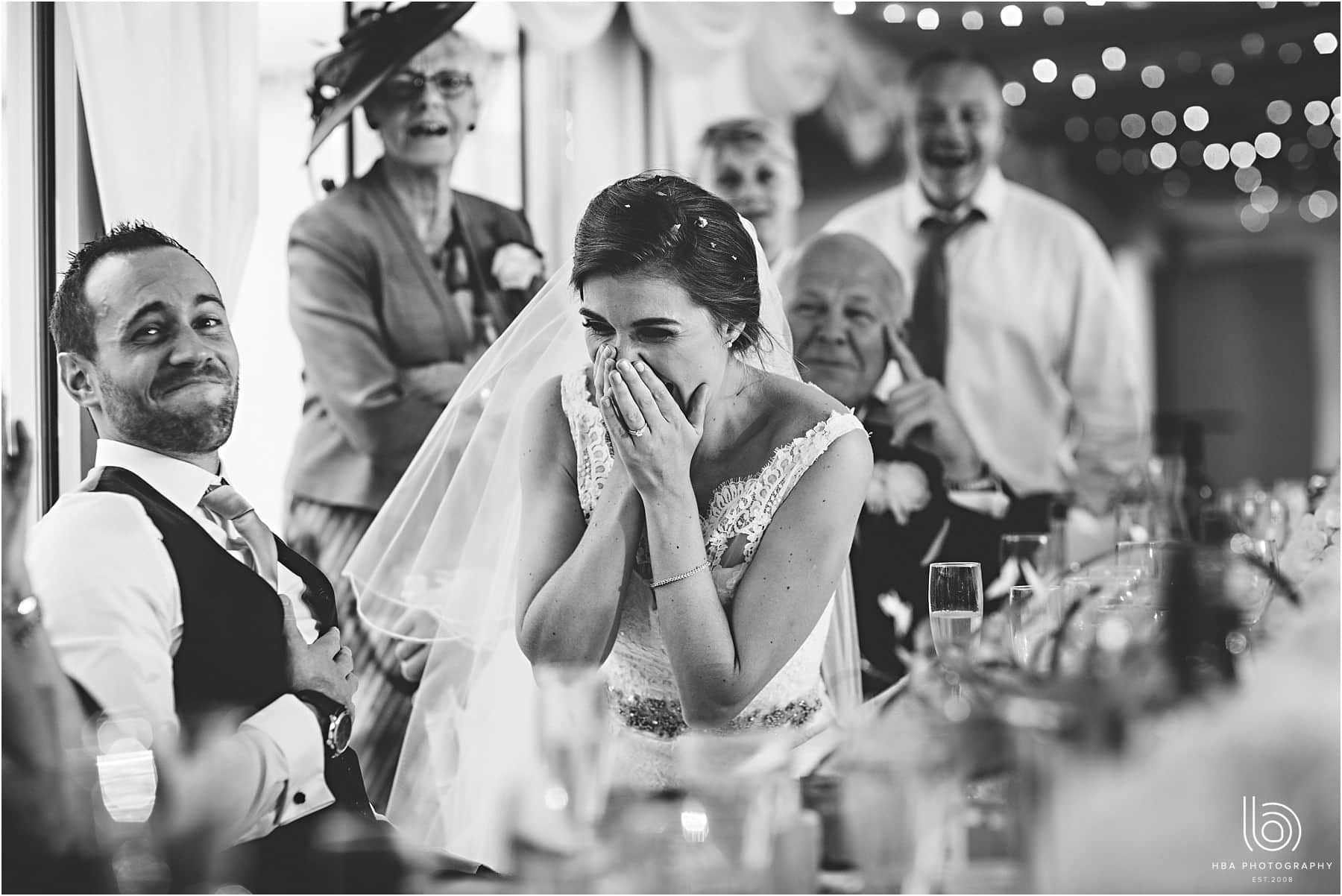 the bride laughing at the best man's speech