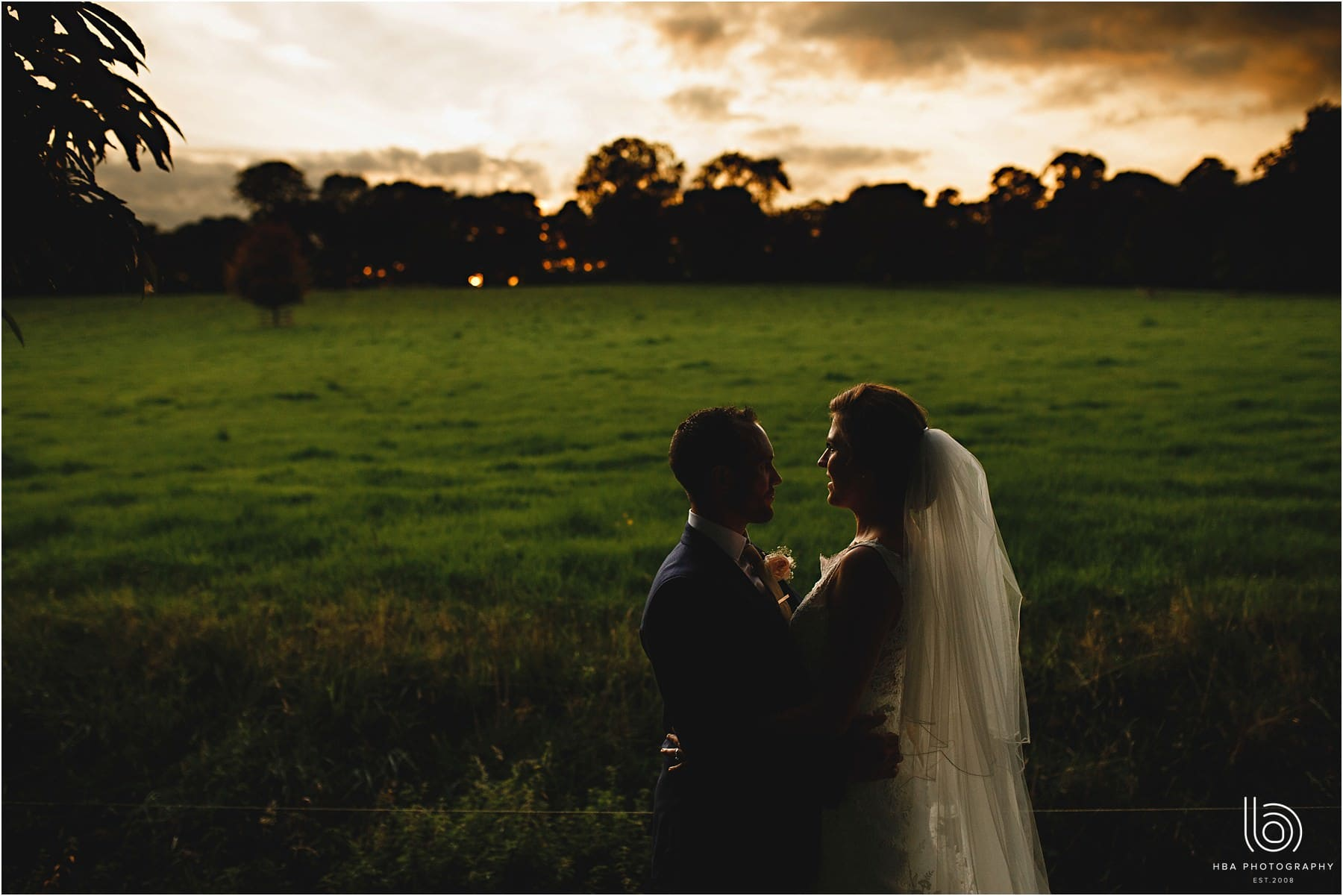 the bride & groom as the sun sets