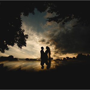 the bride & groom at sunset