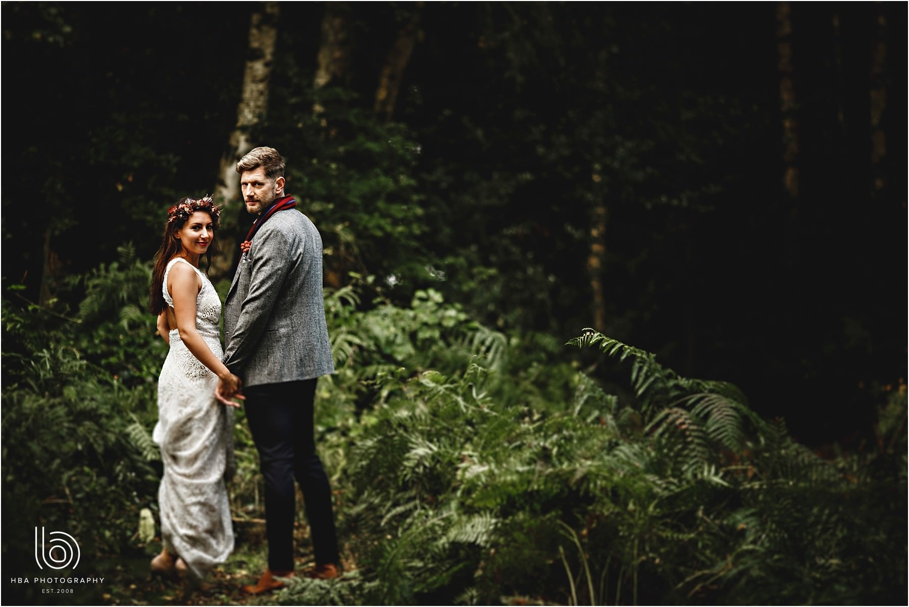 The bride and groom together in the woods on their wedding day