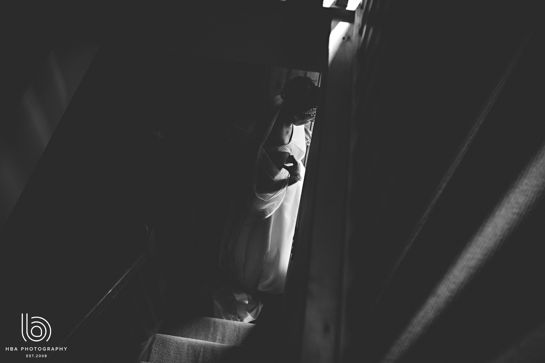 the bride at the bottom of the stairs