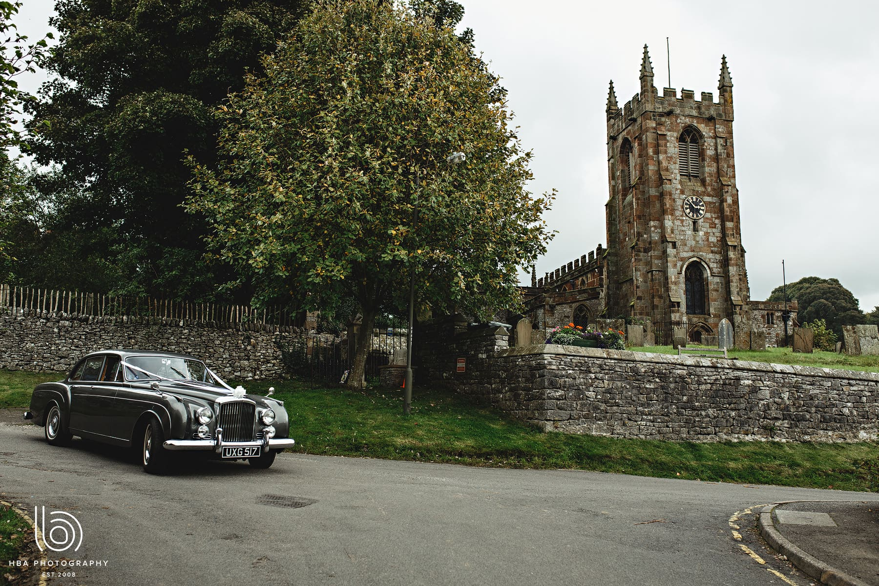 the weddin car at the church