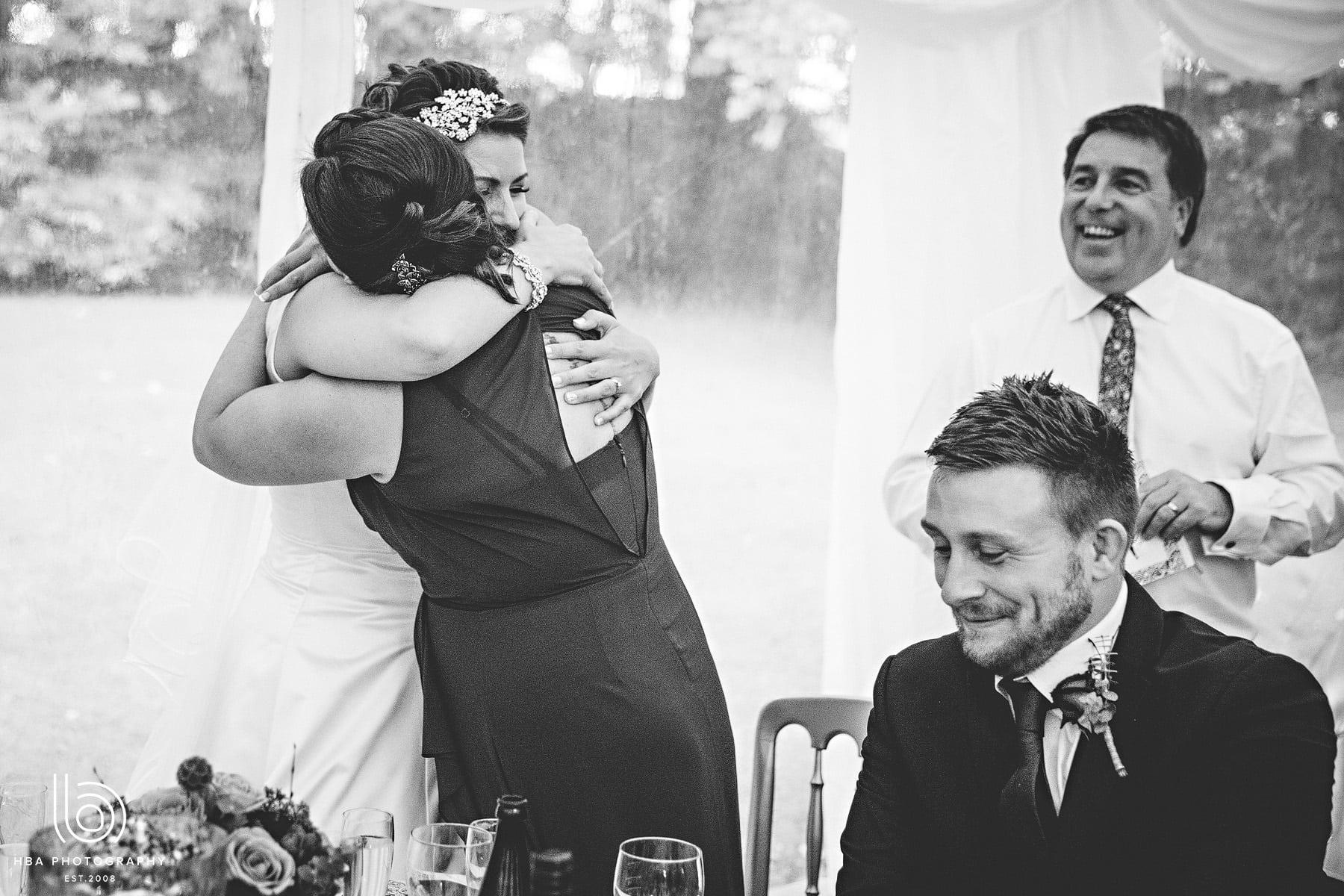 the bride hugging her bridesmaid