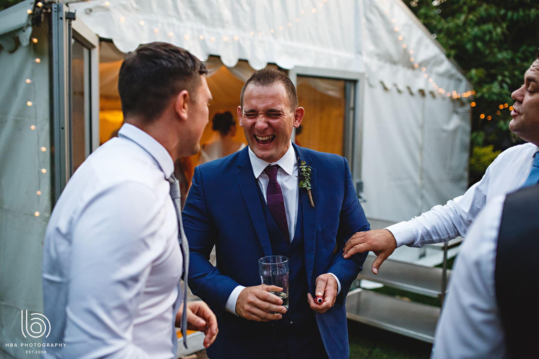 the groomsmen laughing