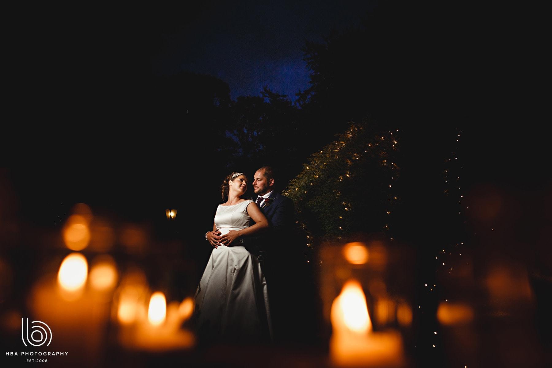 the bride & groom in the twinkle lights