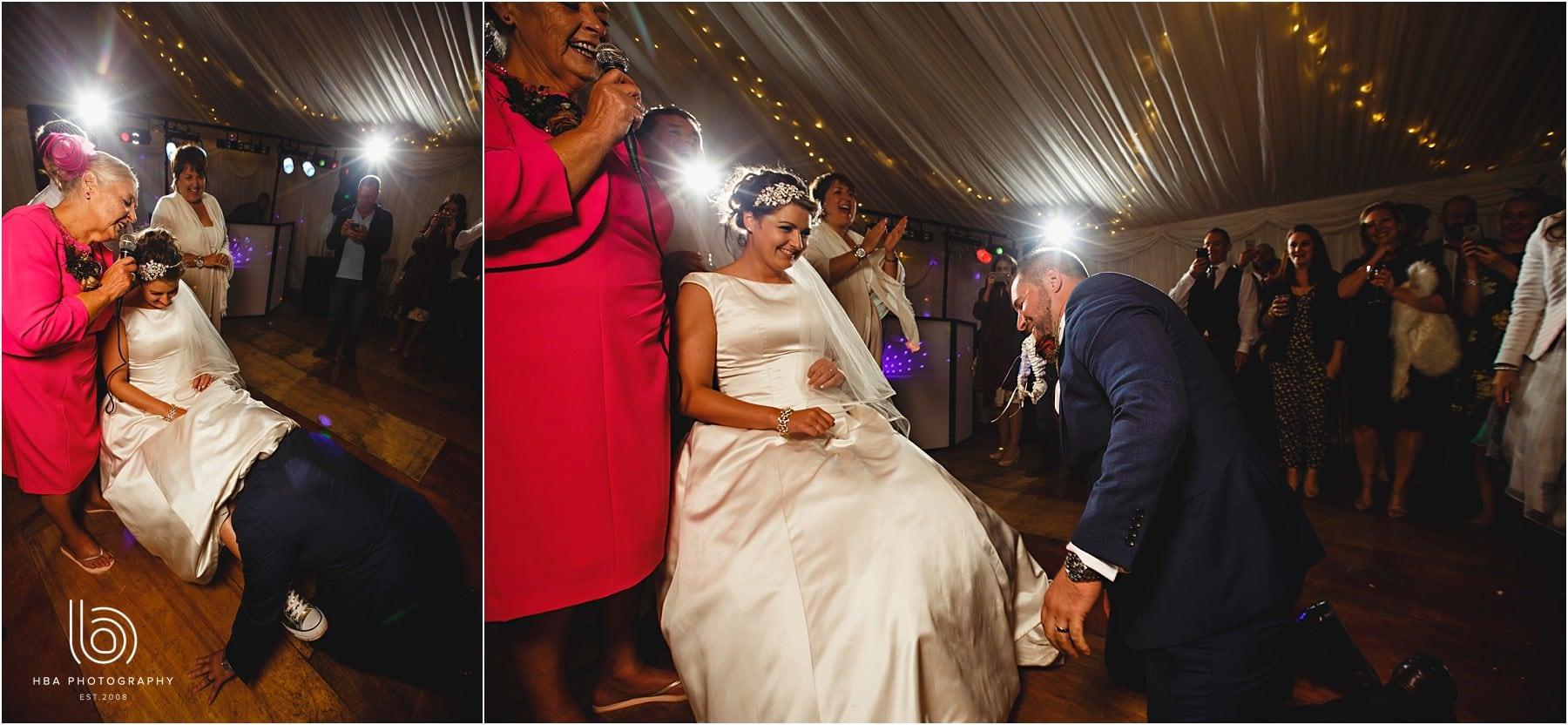 the groom taking off the bride's garter