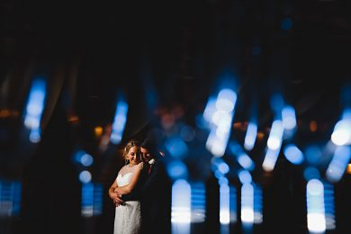 the bride and groom surounded by blue lights