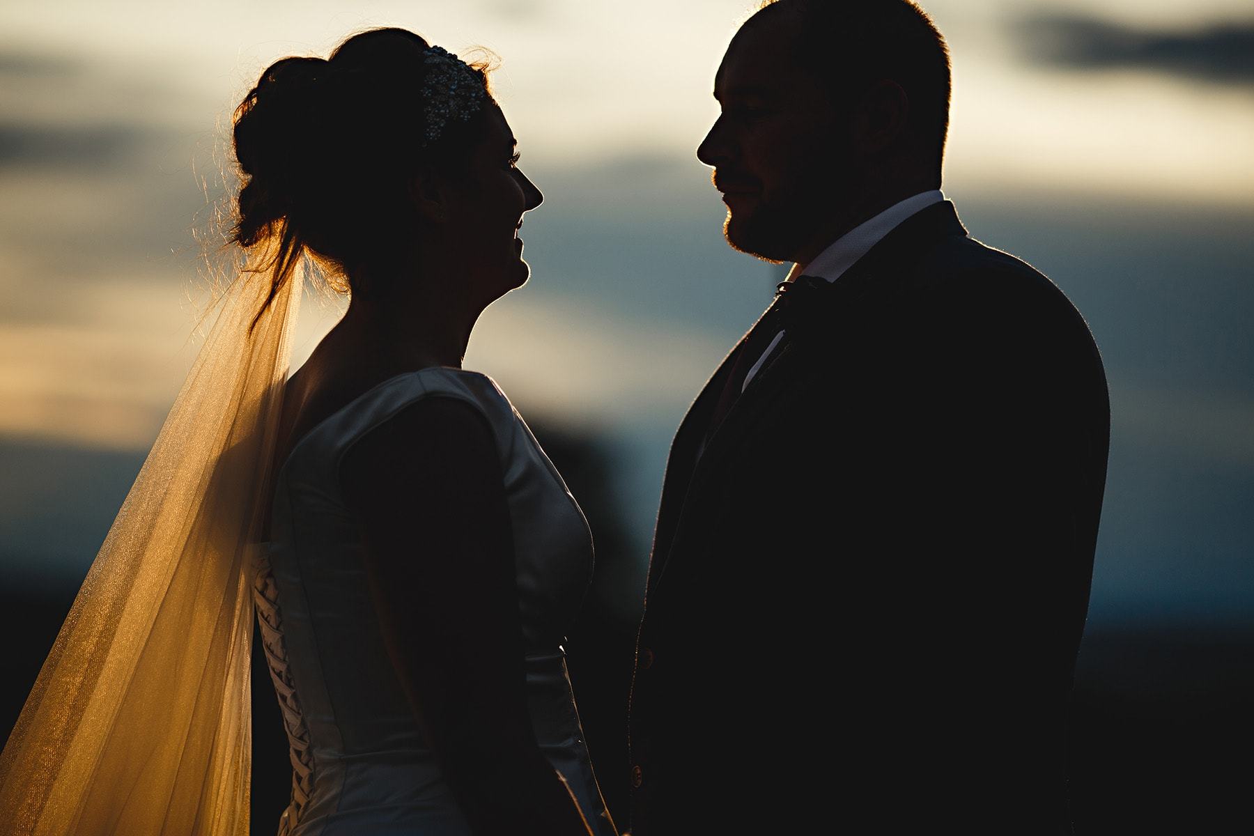 the bride and groom in the sunset at Hartington Hall