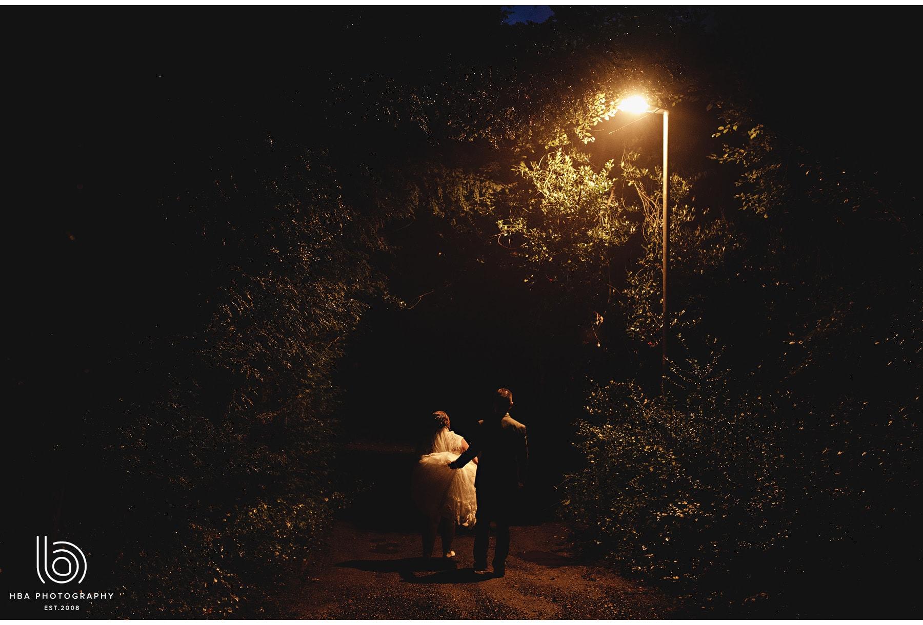 the bride & groom under a street light