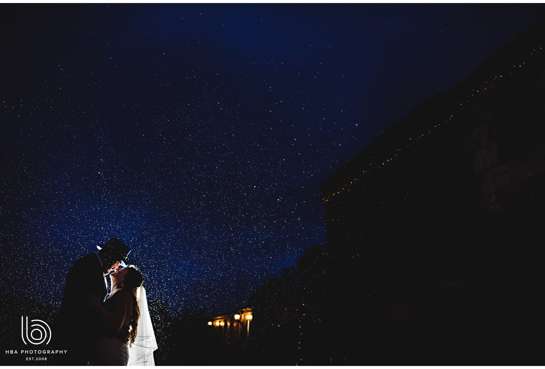 the bride & groom at night outside