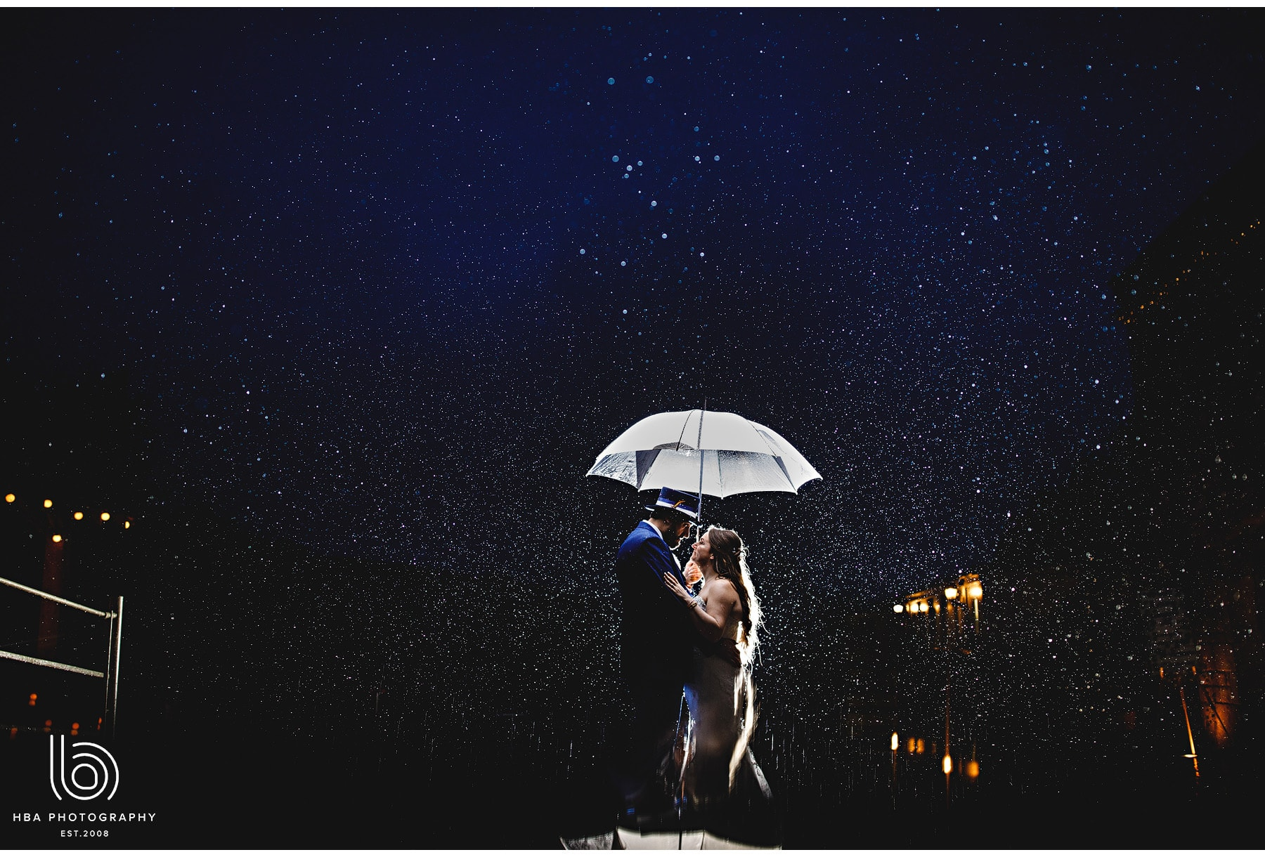 the bride & groom outside in the rain