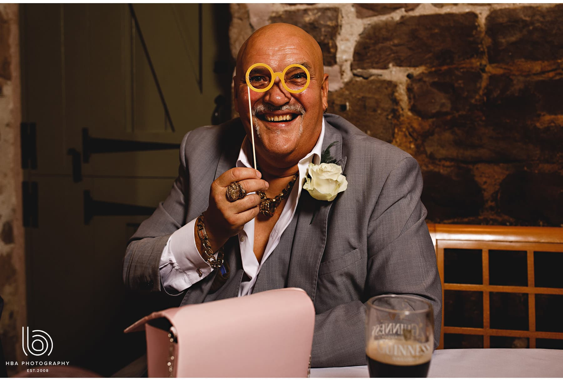 a guest at the wedding wearing funny glasses