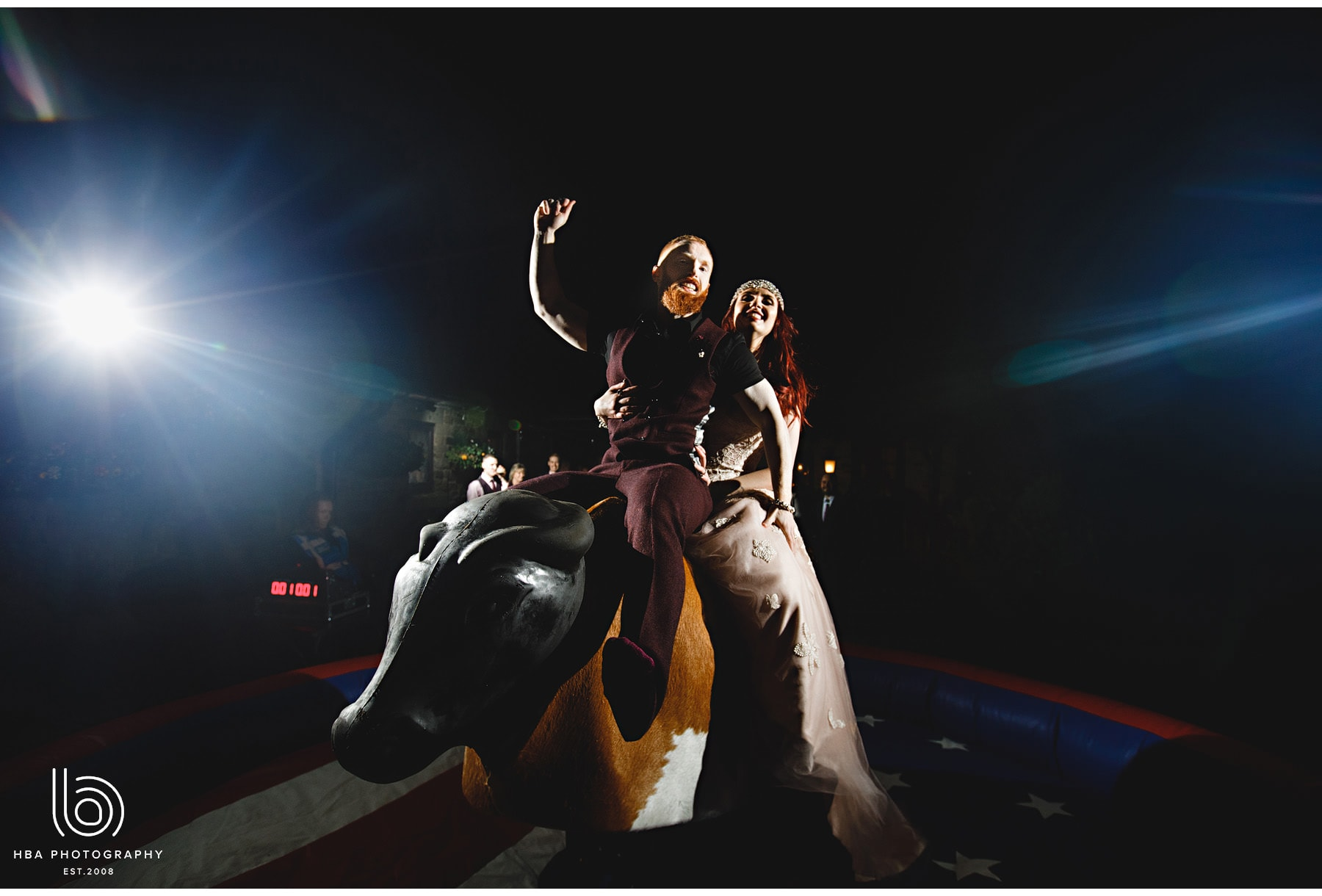 the bride & groom on the bucking bull