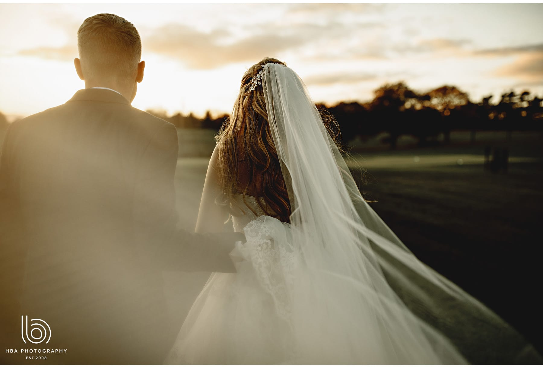 the bride and her veil blowing in the wind