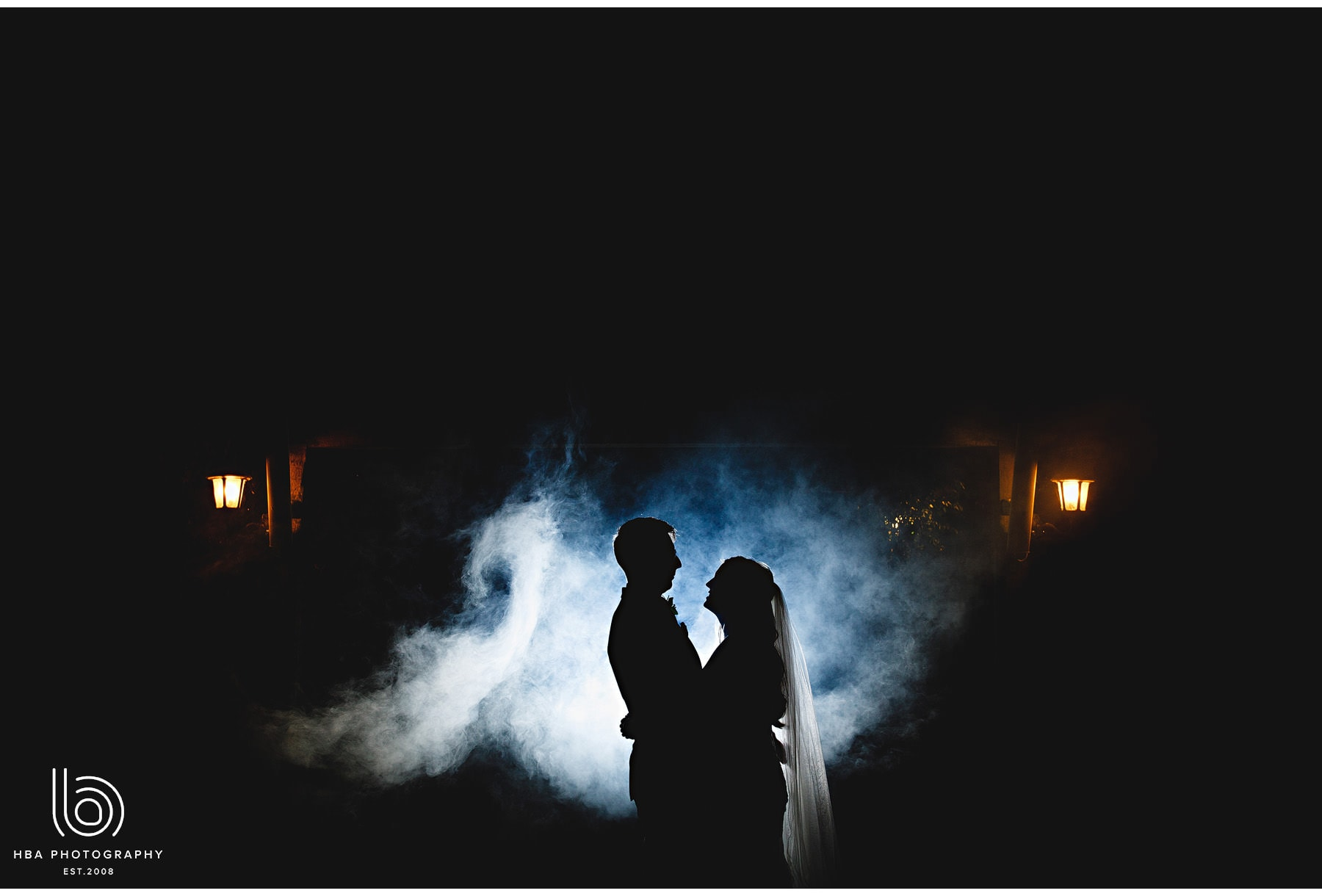 the bride & groom in the smoke