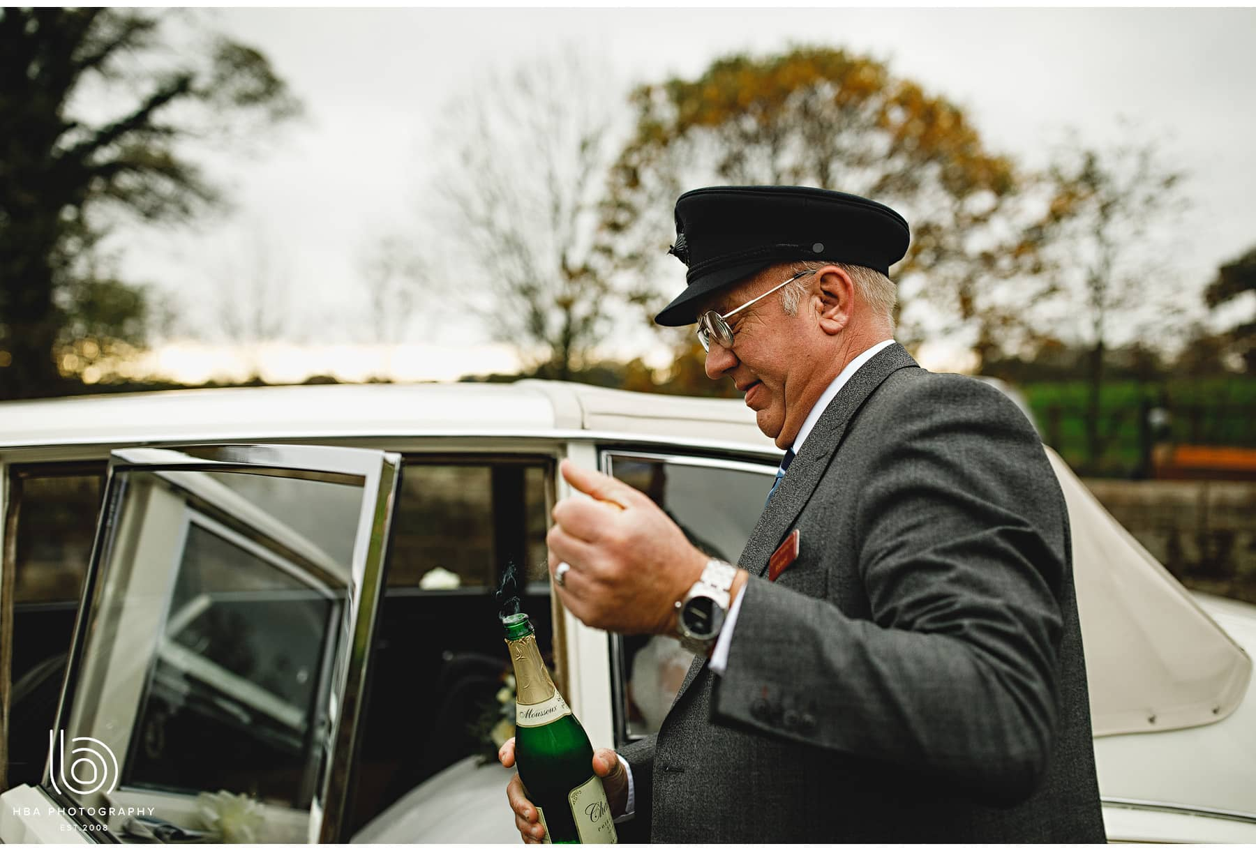 the chauffeur handing out champagne