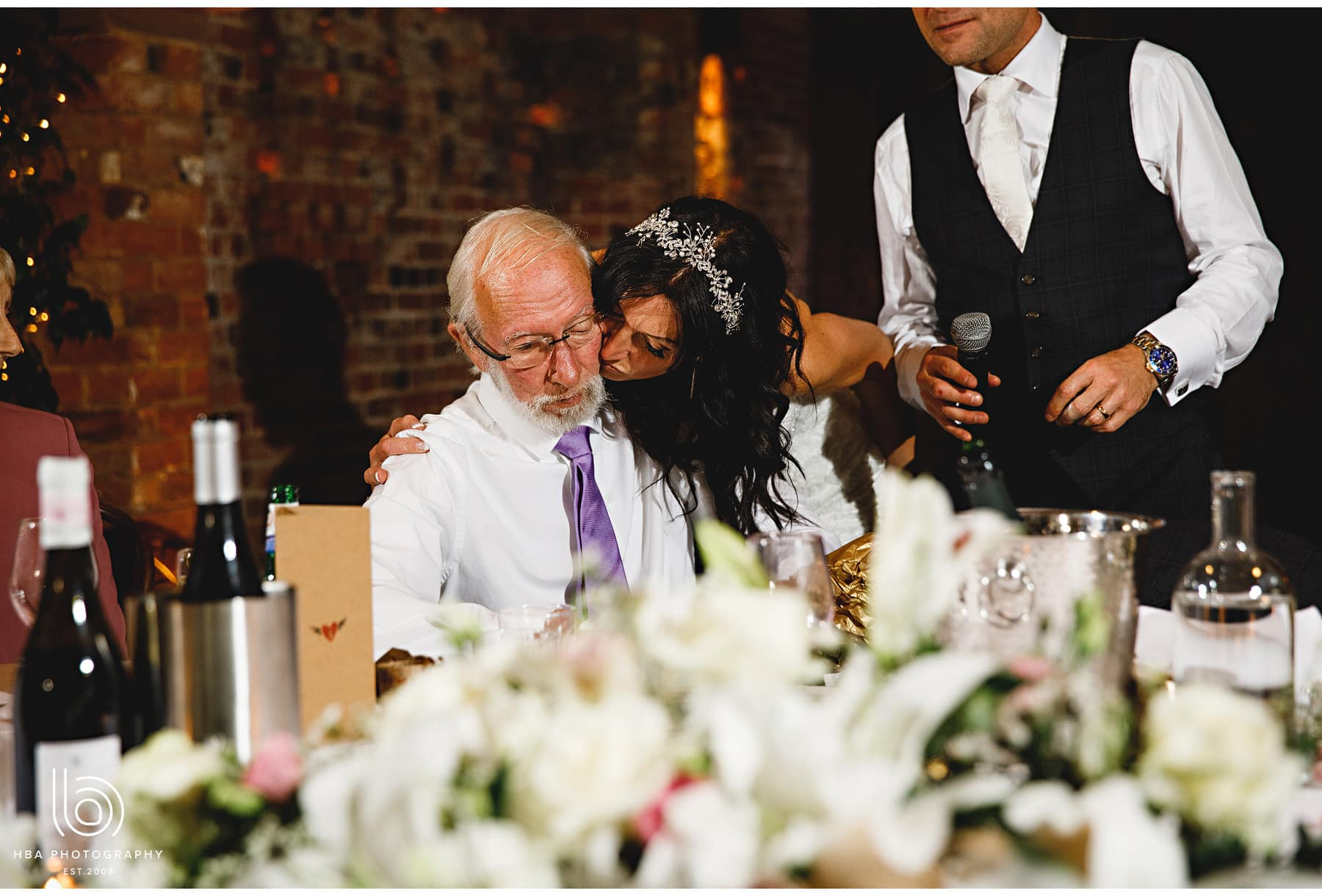 the bride kissing her dad