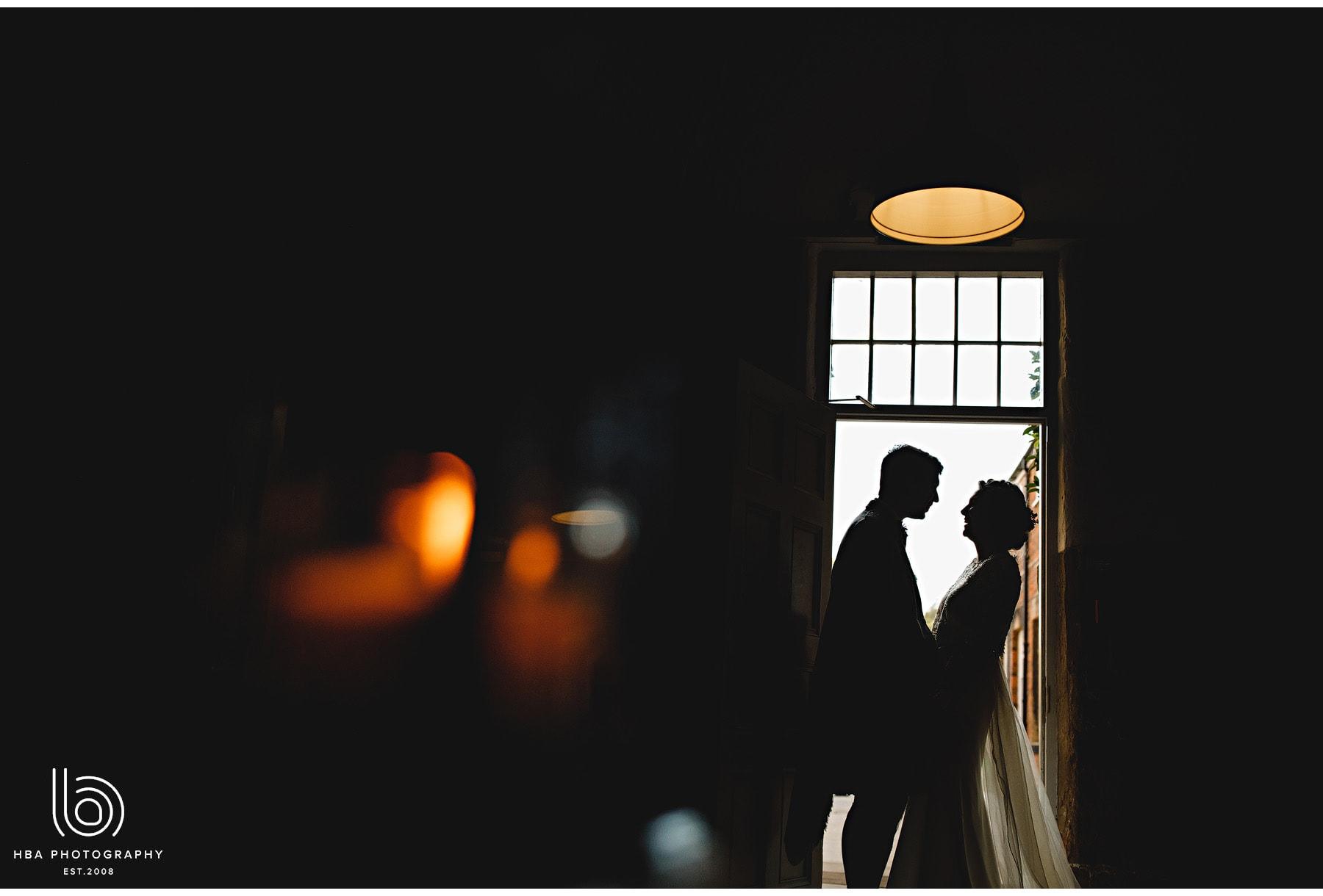 the bride & groom in the doorway in silhouette