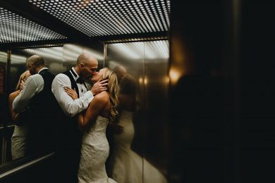 bride and groom kissing in the lift at the west mill