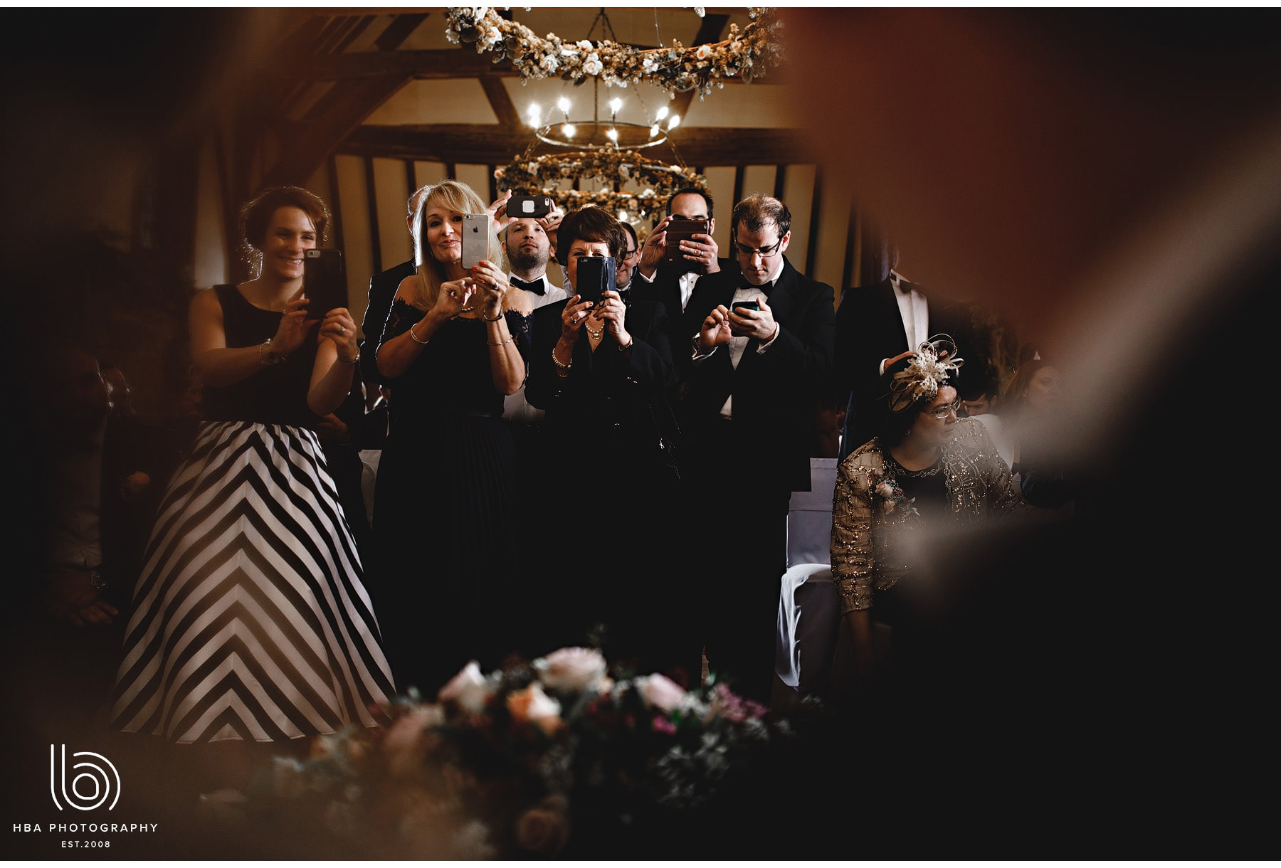 wedding guests taking photos