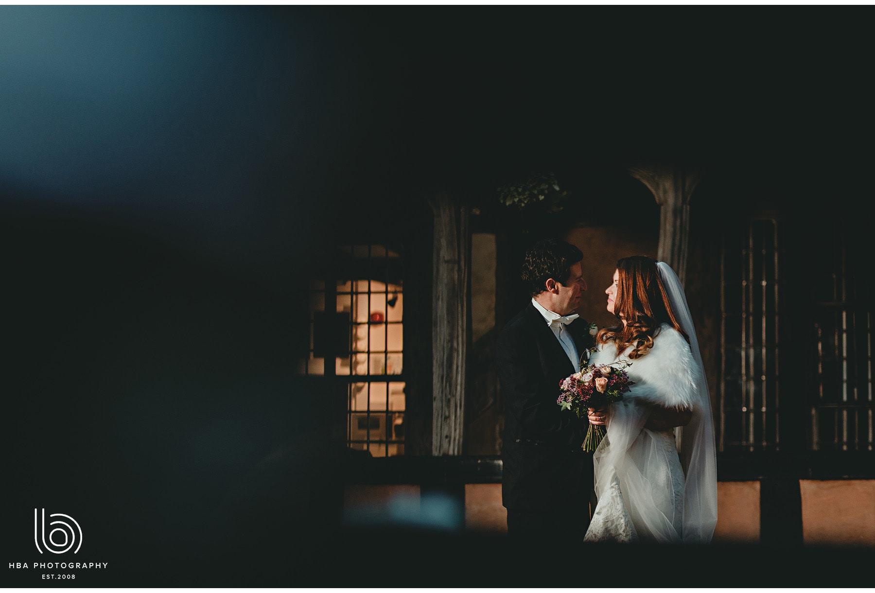 the bride & groom outside lord leycester hospital