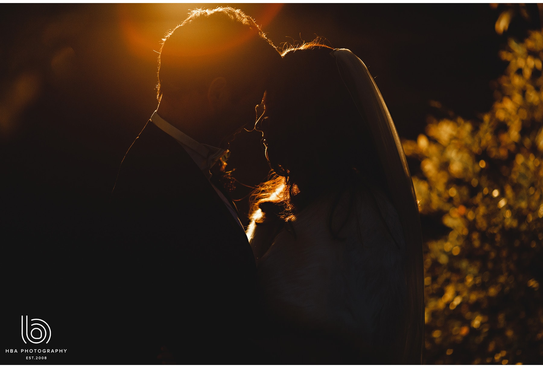 the bride & groom in the golden hour sunshine