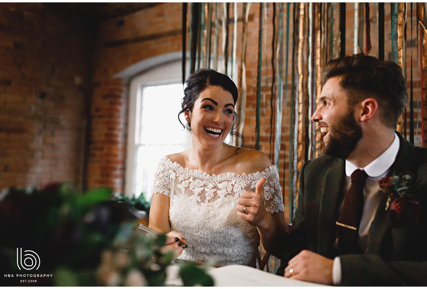 the bride and groom laughing