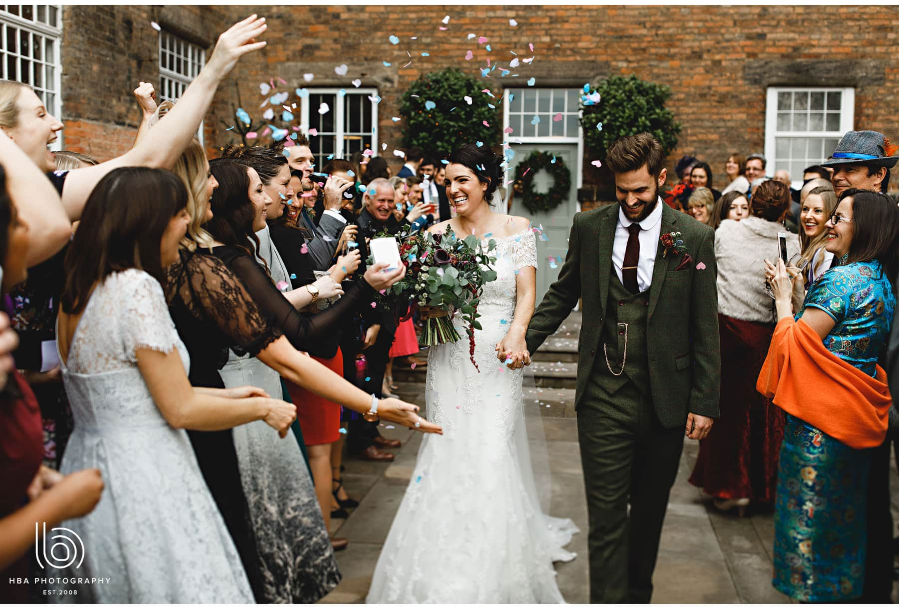 the bride & groom covered in confetti