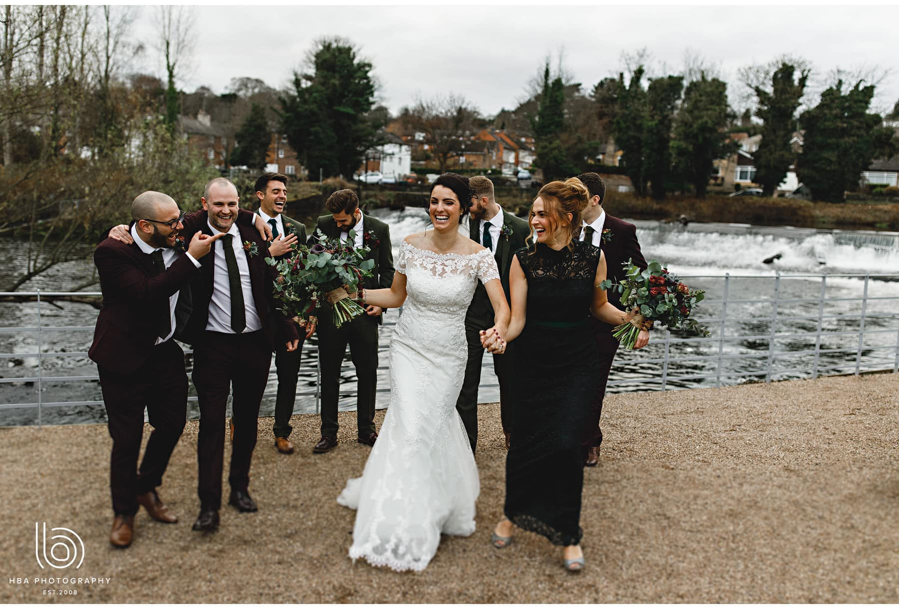 the bride walking with her bridesmaids