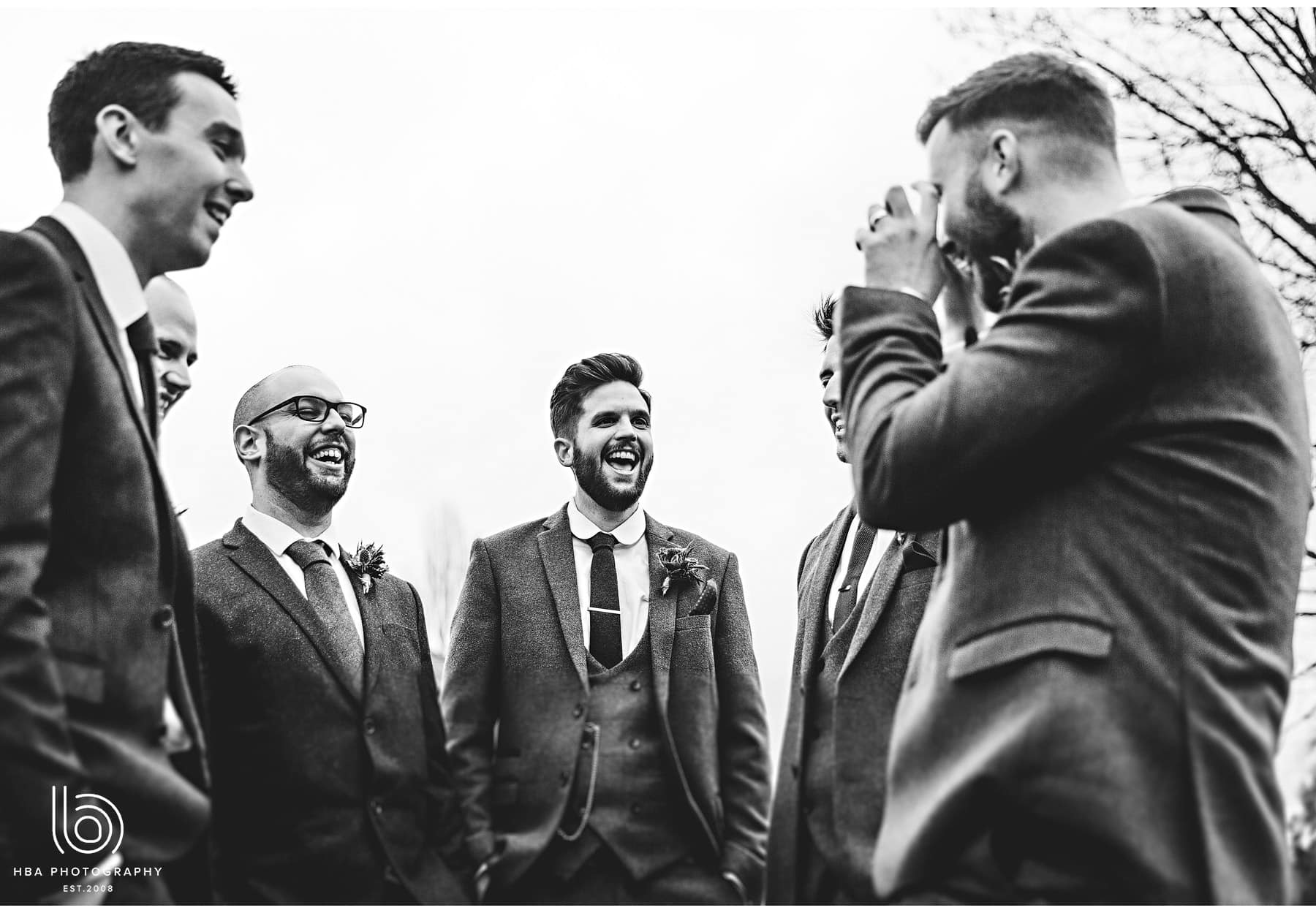 the groom and his men laughing