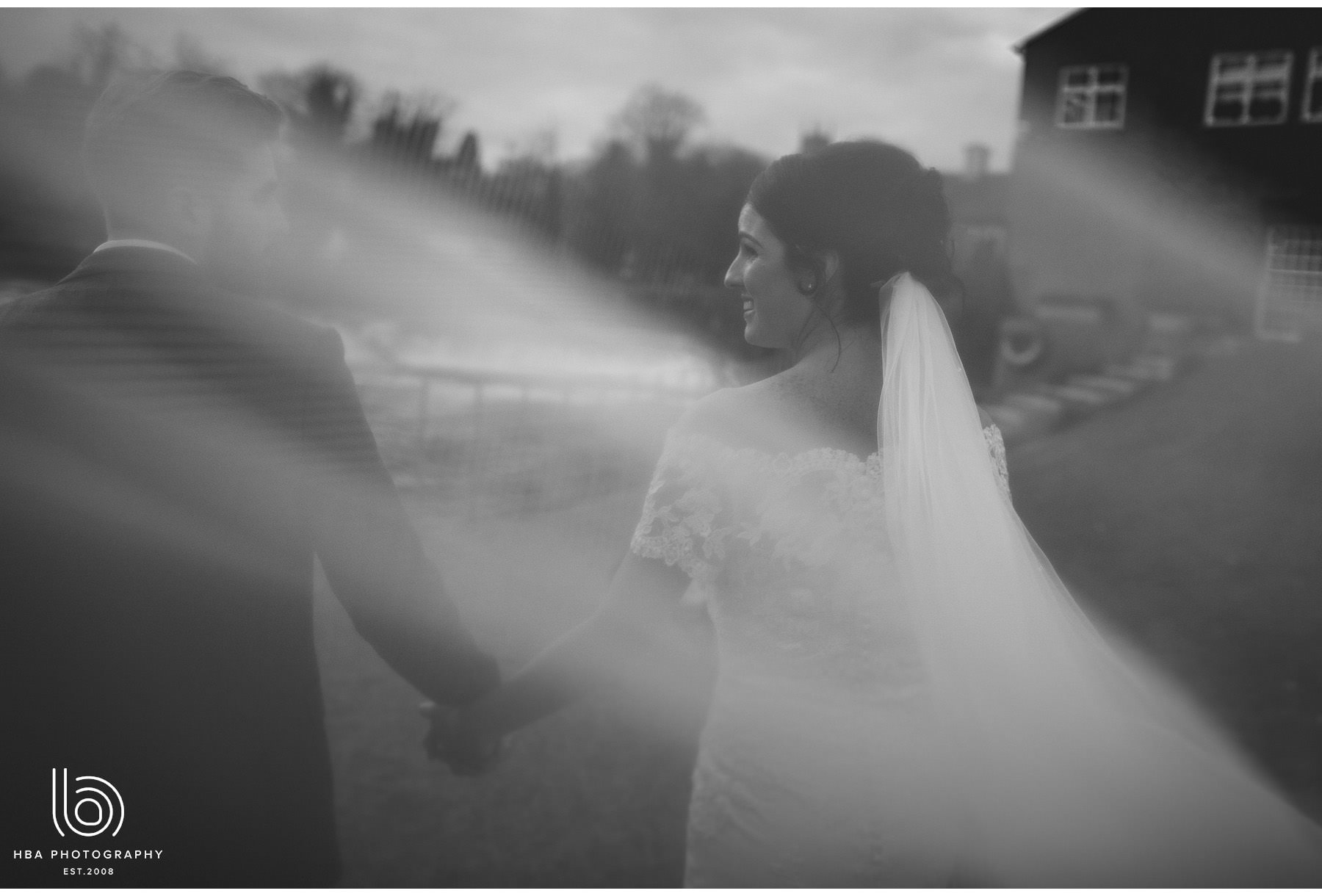 the bride and groom through the veil
