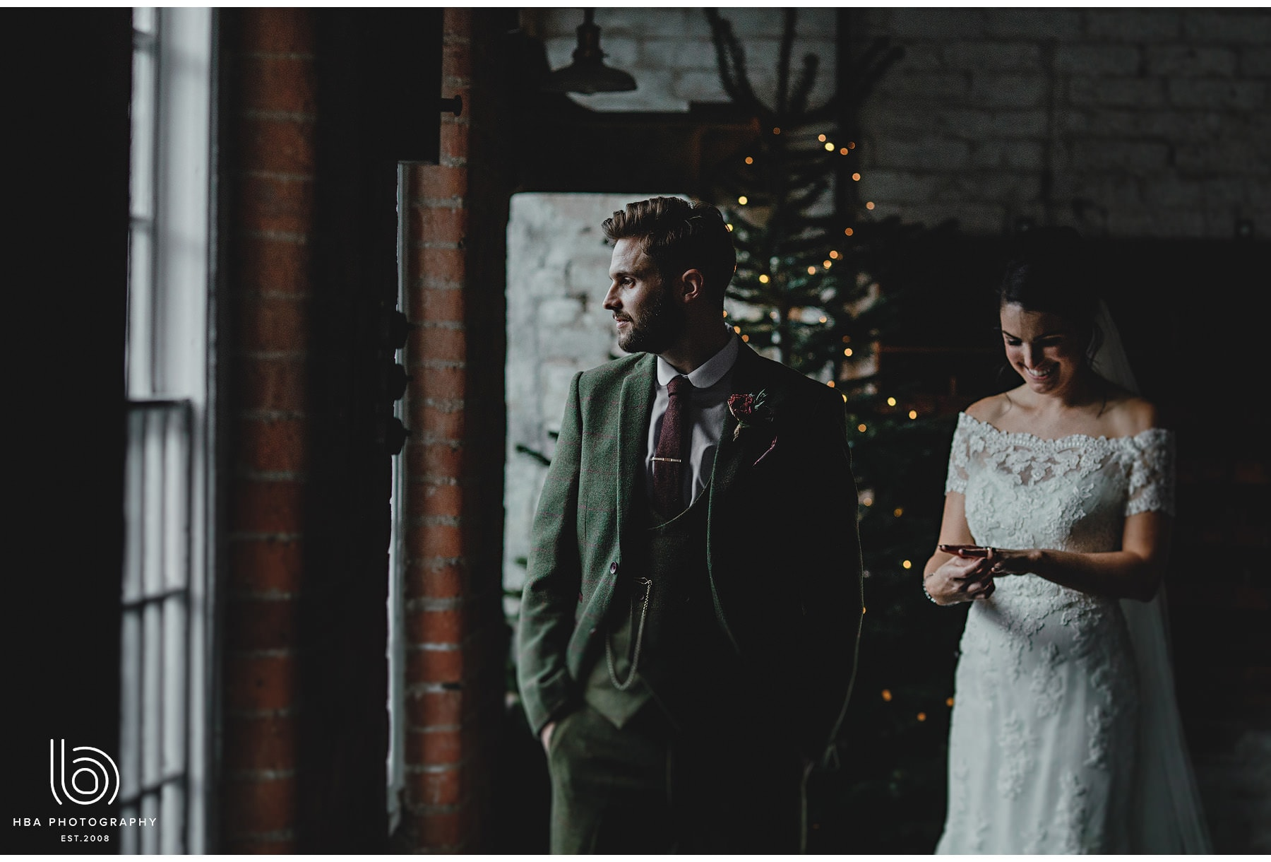the bride & groom by the christmas tree