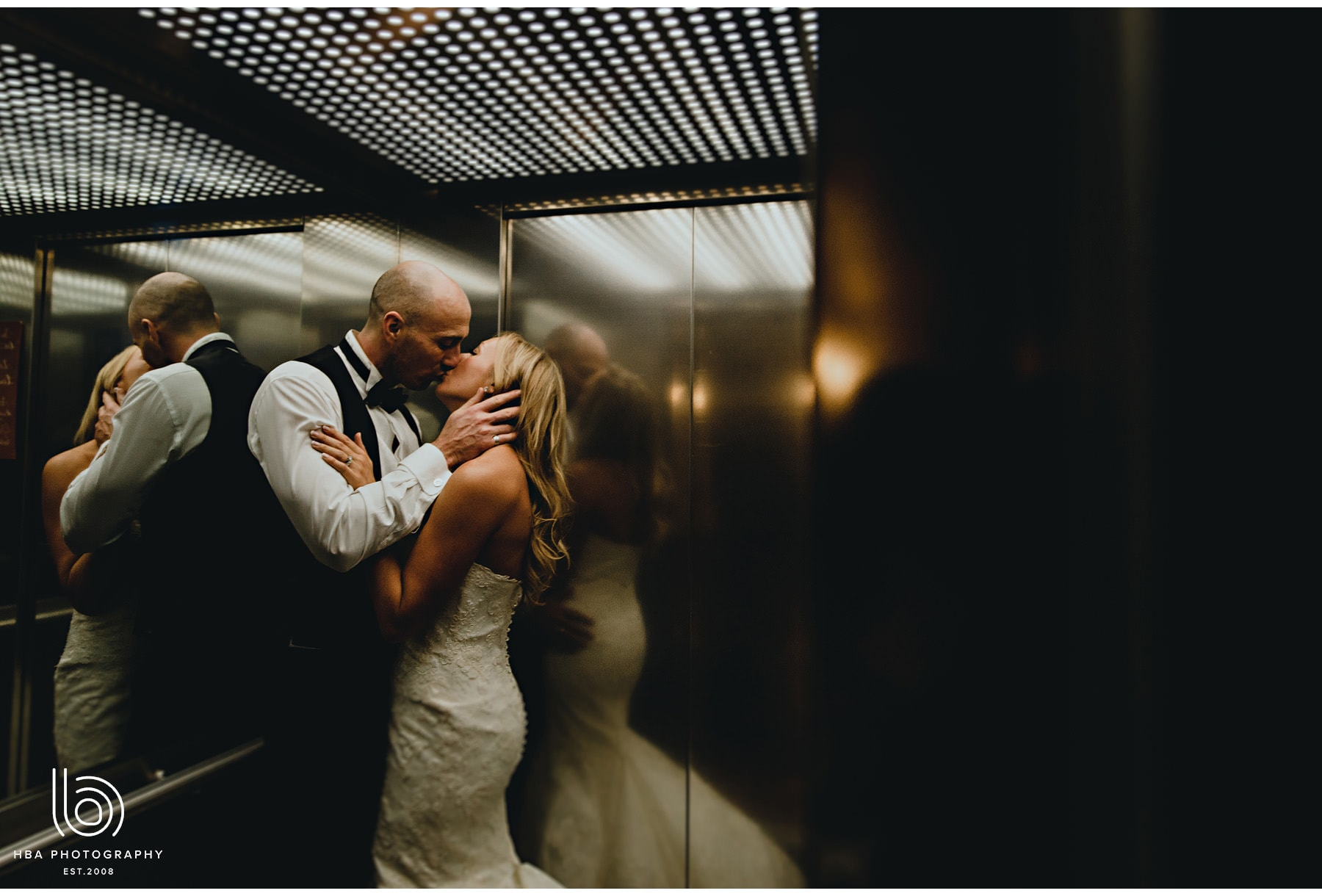 the bride & groom kissing in the lift
