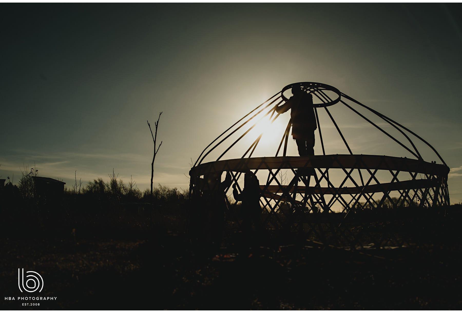 man putting up the yurt