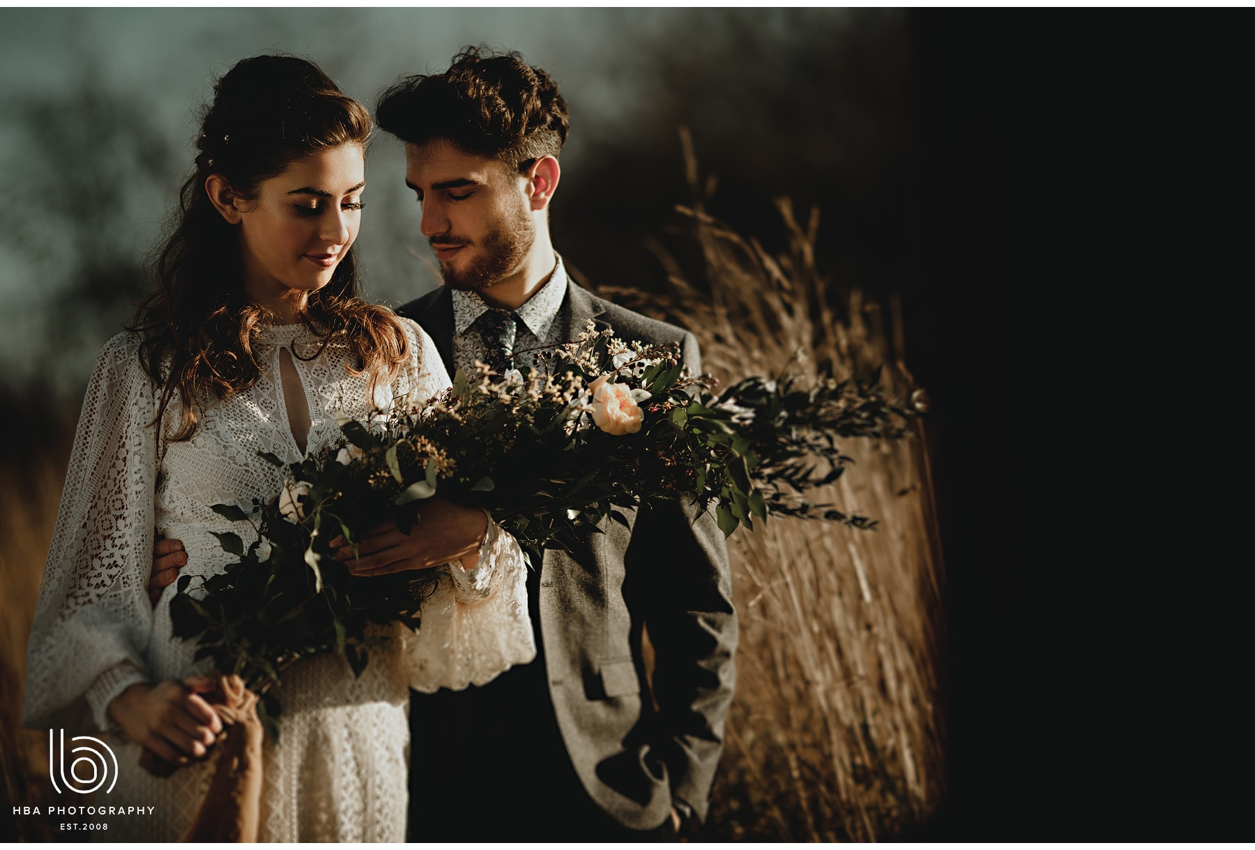 bride and groom together in long grasses