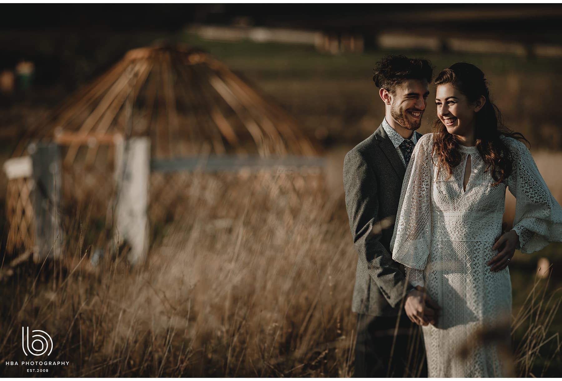 wedding couple together with the yurt in the background