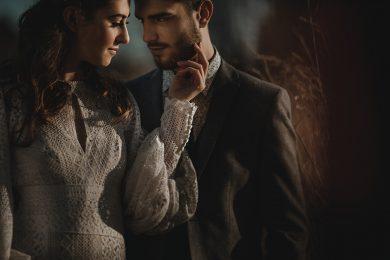 the bride and groom stood togethe rin amongst natural grasses and corn husks