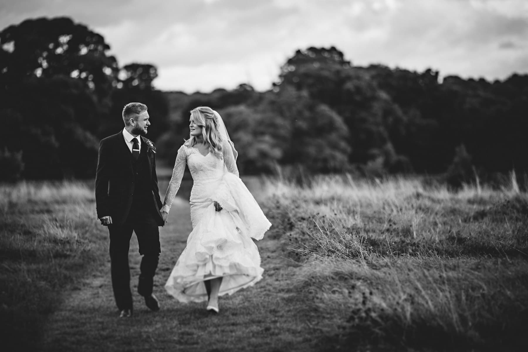 bride and groom walking at calke abbey in derbyshire