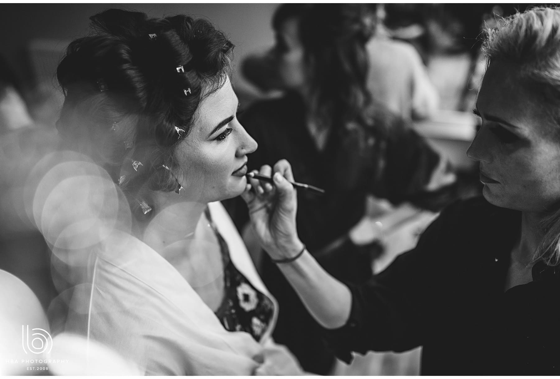 the bride having her lipstick done