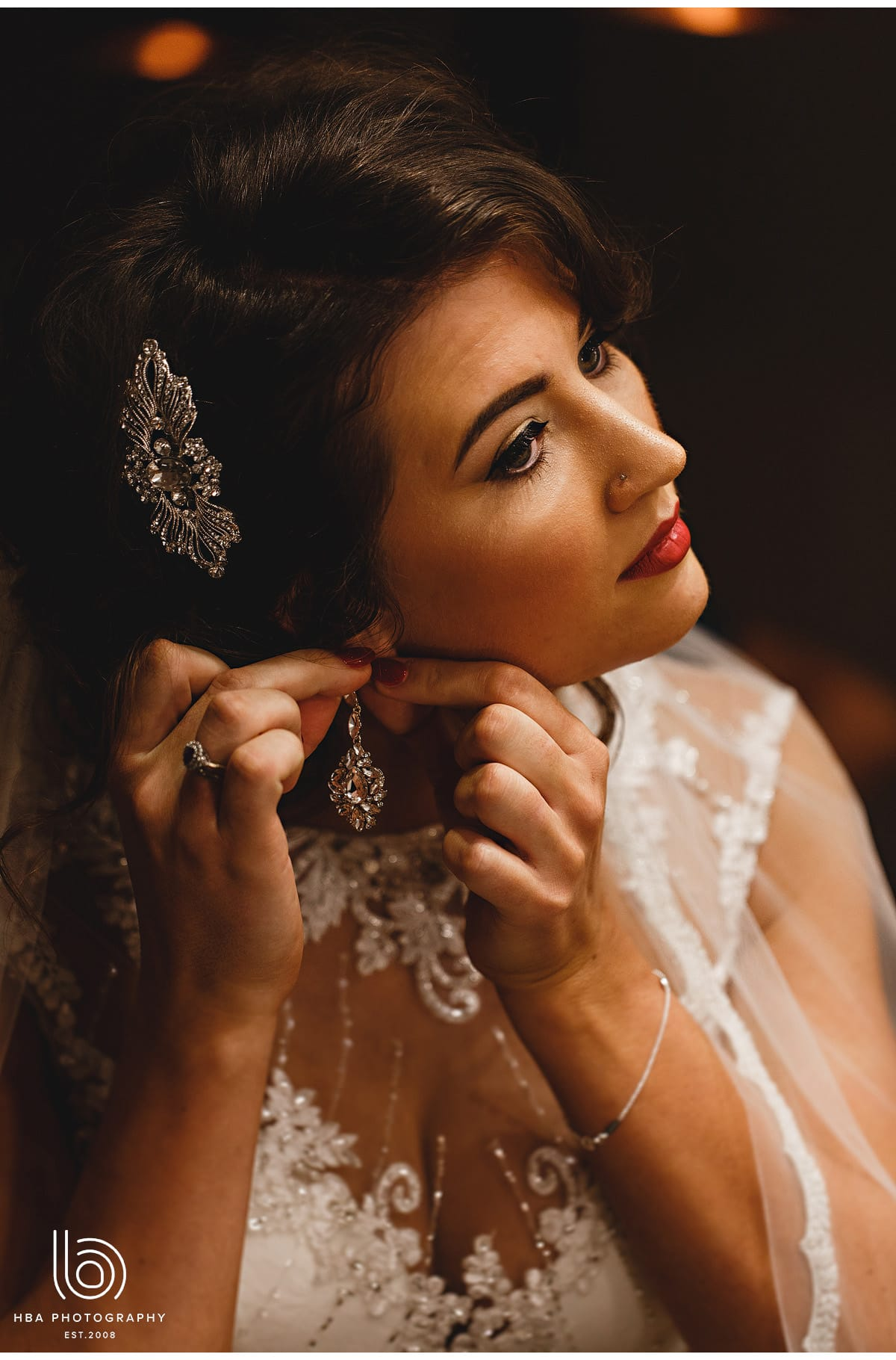 the bride putting her earrings in