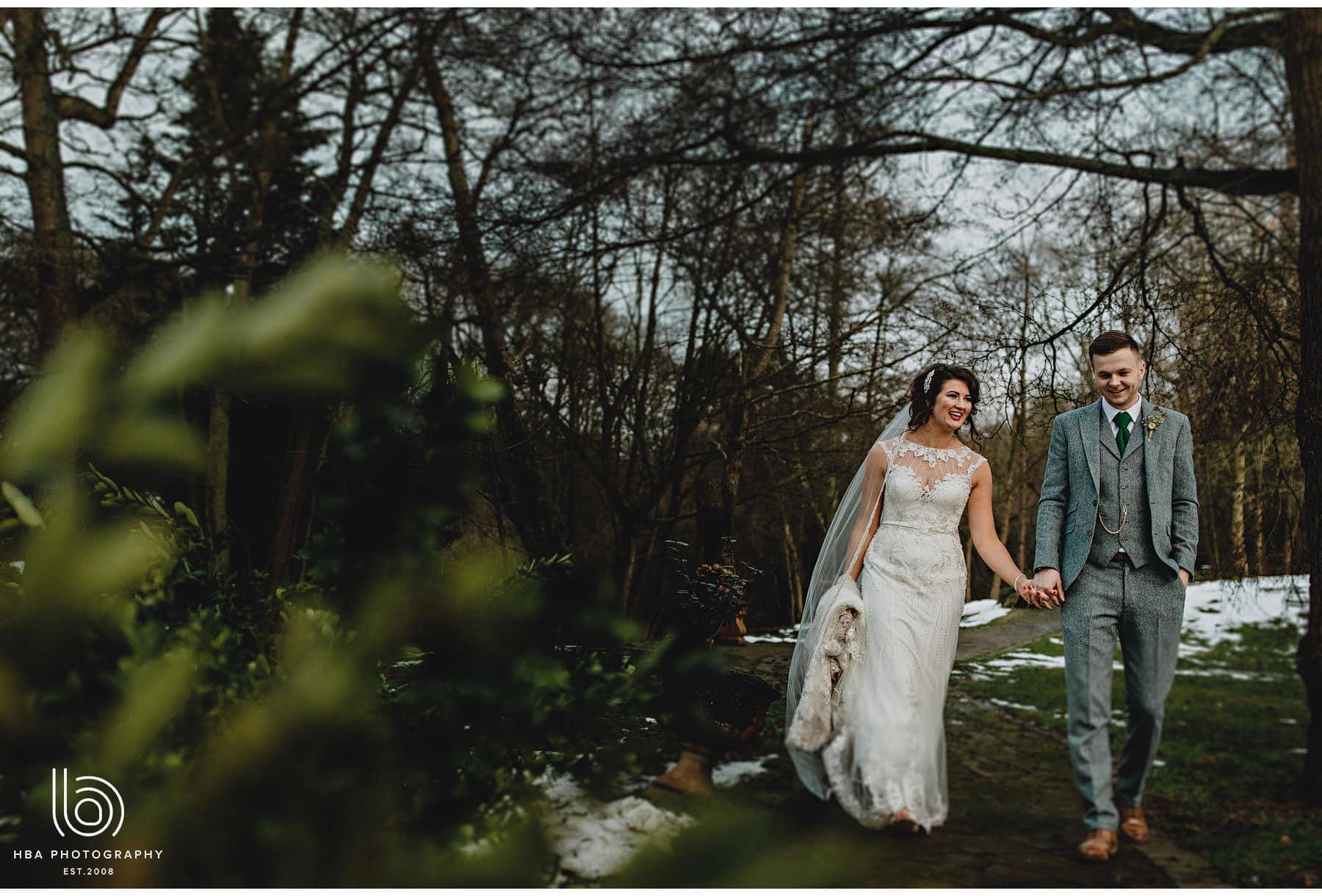 the bride & groom walking in the snow